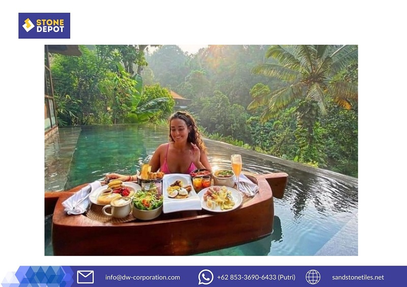 natural-green-pool-floating-food-woman-at-hanging-gardens-of-bali